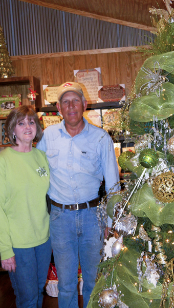 Shirley Burnham / The Prentiss Headlight – This lovely decorated live tree is a part of the gift shop on Bass Christmas Tree Farm.