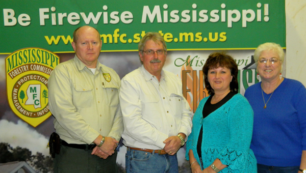 Shirley Burnham / The Prentiss Headlight – FIREWISE Coordinator Leslie G. (Opie) Blackwell, JDC Soil & Water Commissioner James Slater, Hope Daley, and Commissioner Sandra Cole.