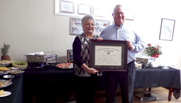 Henry Hamill, Vice President-Sales with Mississippi Farm Bureau presented a Certificate of Appreciation to Mary Jean Hamby recognizing 27 years of service to Mississippi Farm Bureau Insurance.