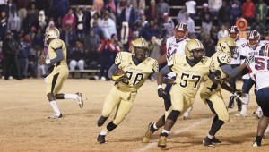 Tony Waits / The Prentiss Headlight – Junior Trodrick Daniels (#28) and Racheem Boothe (#57) easily advance down the field during the runaway South State Championship.