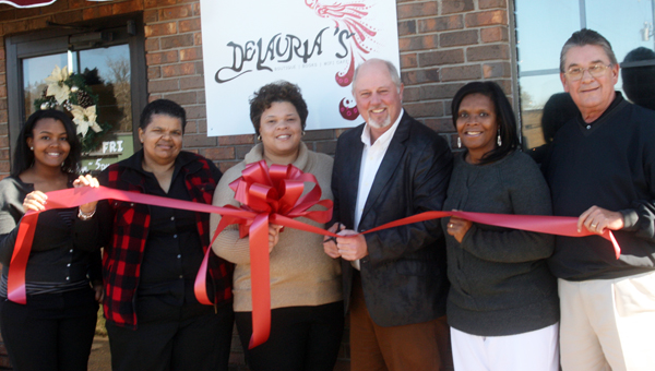 Karen Sanford / The Prentiss Headlight – DeLauria's Boutique / Books / WiFi Café opened their doors this week. On hand for a new business ribbon-cutting was (l to r) Joi Brown, Dedra Brown-Johnson, Owner Laurinda Brown-Johnson, Charley Dumas, Jerleen White and Ben Hamby.