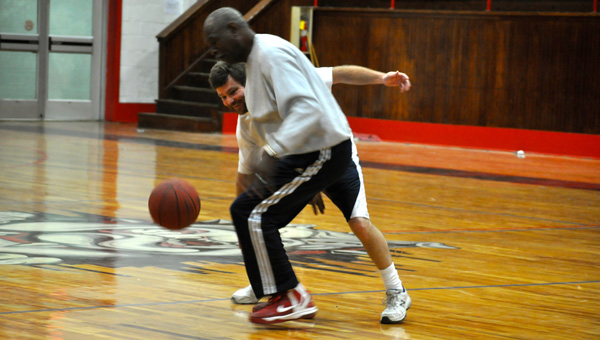 """Holley Kruger Cochran / The Prentiss Headlight – """"Coach"""" Rev. Jessie Holloway defends the ball against Circuit Clerk Clint Langley."""