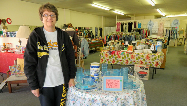 """Shirley Burnham / The Prentiss Headlight – Terri Speights shows off the """"pre-loved"""" merchandise in her newly-opened store, Inside Sale."""