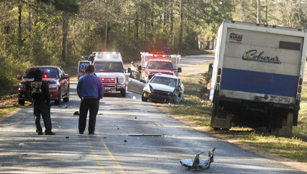 Karen Sanford / The Prentiss Headlight –Kristen McRaney of Bassfield was involved in a car crash on Monday morning with a log truck. She was taken to Forrest General Hospital with injuries. Above, emergency personnel respond to the accident on North Williamsburg Road in Bassfield.