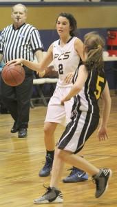 THE PRENTISS HEADLIGHT / Hollis Cochran bringing the ball down the court.