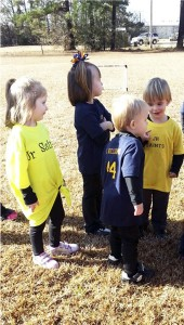 THE PRENTISS HEADLIGHT / Soccer players Riley Jace Snellgrove, Mary Ella Bass, Landyn Williams, and Corbin Stamps engaged in learning the rules of soccer. First game was held Saturday for the Jr. Saints.