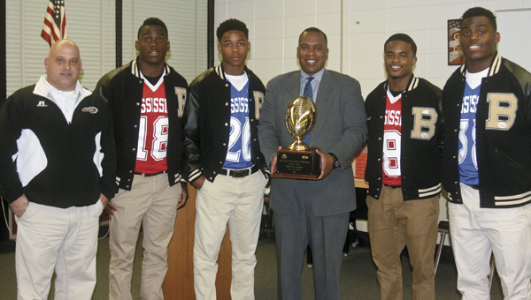 Karen Sanford / The Prentiss Headlight – Bassfield Yellowjackets Team Captains pictured ( l to r) Coach Lance Mancuso, C J Moore, Cornell Armstrong, Superintendent of Education Ike Haynes, Curtis Mikell and Alvin Moore.