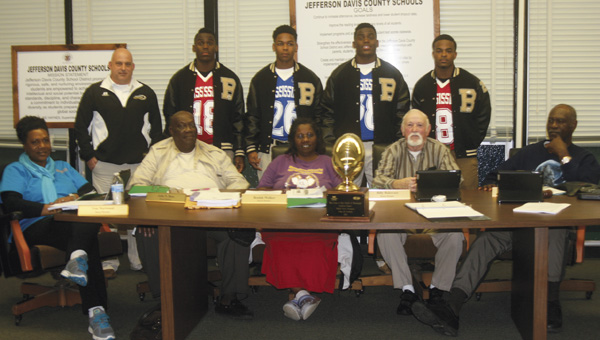 Karen Sanford / The Prentiss Headlight – The Jefferson Davis County School Board members pictured (l to r) Von Norwood, John Bass, Beulah Walker, Billy Boleware, and Jessie Holloway. Bassfield Yellowjackets pictured (standing l to r) Coach Lance Mancuso, C J Moore, Cornell Armstrong, Alvin Moore and Curtis Mikell.