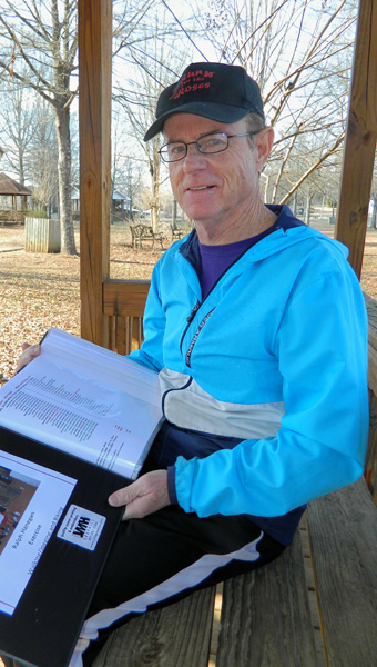 Shirley Burnham / The Prentiss Headlight — Ralph Hanegan completed a 10,000 mile journey running, walking and cycling in a five year period. Most of Hanegan's miles were logged in on the LongLeaf Trace. His son and grandchildren joined him on some of his runs. His logbook has become a scrapbook of memories as well.