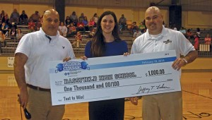 "Karen Sanford / The Prentiss Headlight—Bassfield High School was the winner of the Class 2A ""Text to Win"" Contest. Accepting a $1,000 check from Blue Cross Blue Shield is (l to r) Coach Lance Mancuso, Meredith Virden, Manager, Corporate Communications at Blue Cross & Blue Shield of Mississippi, and BHS Principal John Daley"