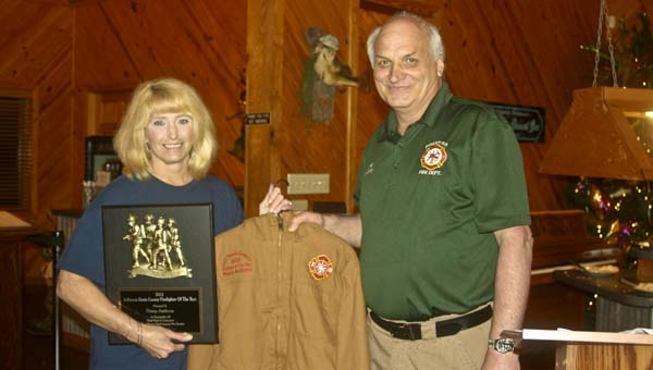 Karen Sanford / The Prentiss Headlight —Penny Anthony of the Oakvale Fire Department was recognized as the county-wide Firefighter of the Year at the 12th Annual JDC Firefighter Banquet held at the Country Fisherman last Tuesday night. Prentiss Fire Chief Howard Kelly presented her with a plaque and a firefighter jacket.