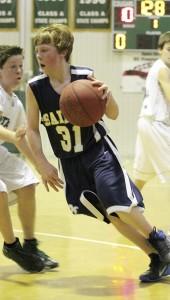 THE PRENTISS HEADLIGHT /Wade Watkins driving to the basket.