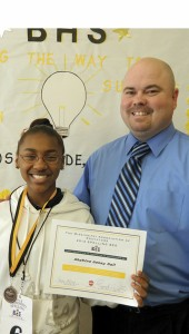 Shirley Burnham / The Prentiss Headlight—Shakira Hall represented JDC School District in the State Spelling Bee broadcast by PBS. Hall is shown here with her medal and certificate with BHS Principal John Daley.