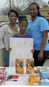 Shirley Burnham / The Prentiss Headlight—Parent helper Dionna Evans, Troop member Javia Newsome and Troop Leader Lafarrah Newsome worked on selling their last stash of Girl Scout cookies in front of Rameys in Prentiss.