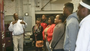 Karen Sanford / The Prentiss Headlight—Press operator Malcolm Stewart demonstrates to Bassfield journalism students the process for printing a newspaper.