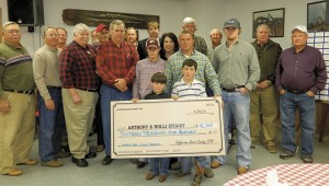 Shirley Burnham / The Prentiss Headlight—Directors of the Jeff Davis County Forestry Commission presented the Stuart family with a check for $16,500.