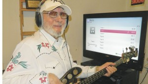 Shirley Burnham / The Prentiss Headlight—Legendary bass guitar player Tommy Fortenberry practices getting ready to record his bass guitar playing to be added to accompaniment music CDs. He turns 79 this month.