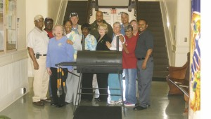 Holley Cochran / The Prentiss Headlight—Unity in the Community members with the grill to be given away during the Fireworks Festival July 4.