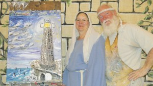 Shirley Burnham / THe Prentiss Headlight—Wade Burleigh completed this unique painting at Whitesand Baptist Church while his wife told of God's great love for man.
