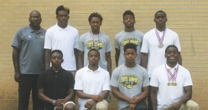 Holley Cochran / The Prentiss Headlight—Bassfield High School 2A track & field state champions: Standing L to R: Coach Charlie James, Jamal Peters, Xavier Harper, Kameron Williams,  Calvin Moore. Kneeling L to R: Dantario Magee, Curt Mikel, Cornell Armstrong, Alvin Moore. (Not pictured: James Hinton).