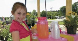 Shirley Burnham / The Prentiss Headlight—Miley Andrews serves her lemonade up with a smile on National Lemonade Day.