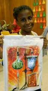 """Shirley Burnham / The Prentiss Headlight—11 year-old DeJah Collins has her """"goody bag"""" filled with fun stuff from the South MS Summer Reading Program."""