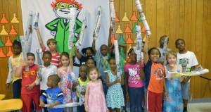 Shirley Burnham / The Prentiss Headligh—Summer Reading Program kids at Prentiss display their weight-bearing bridges.