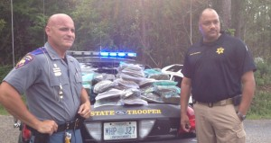 Mississippi Highway Patrol Captain Steven Shows and Jefferson Davis County Sheriff Ron Strickland with the estimated 200 lbs. of marijuana seized from the trunk of the suspect's car after a multi-county high speed chase ended in Jefferson Davis County.