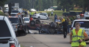 Holley Cochran / The Prentiss Headlight—Emergency personnel assisting the occupants of the truck involved in a three-car accident on HWY 13 south Monday afternoon.